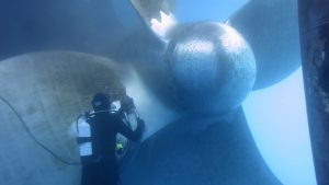 diver cleaning propeller