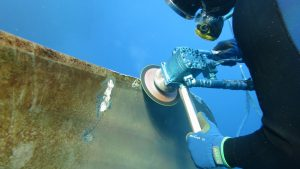 diver polishing propeller